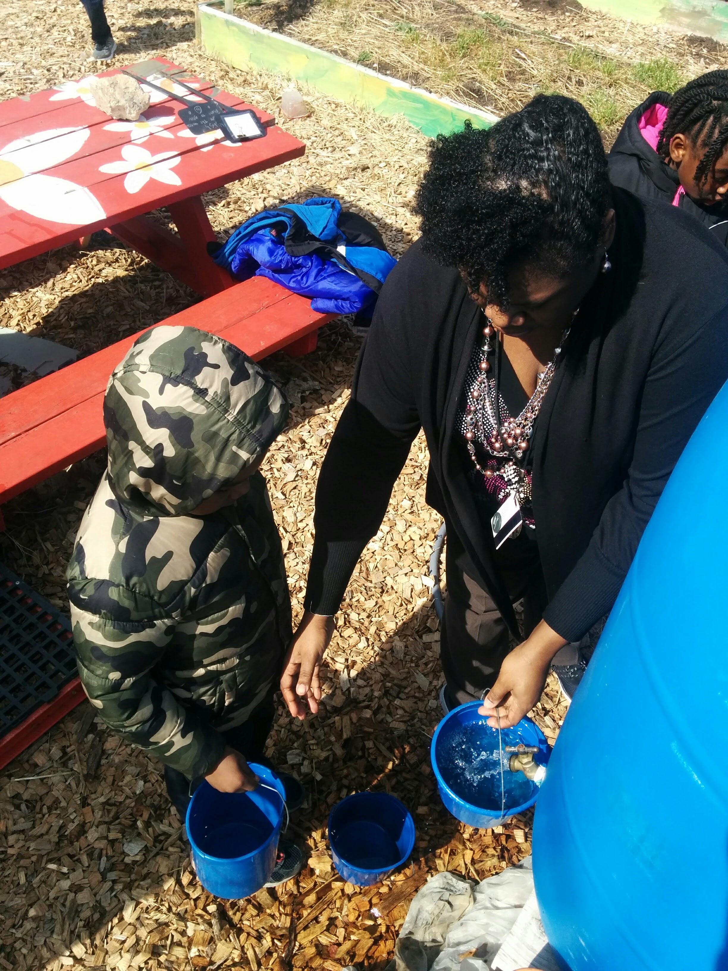 Nina Warren with students in Clay Elementary School Garden 02