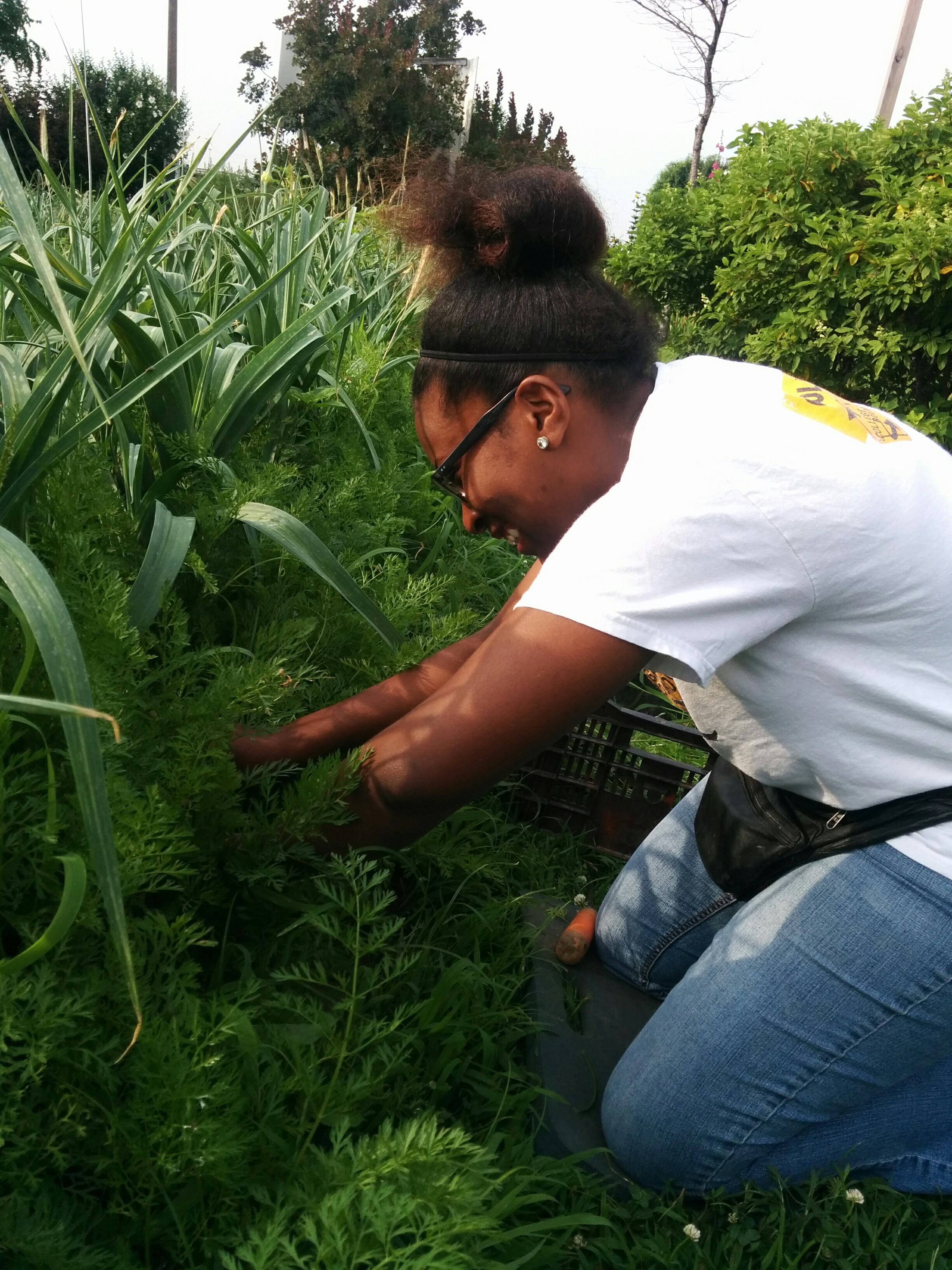 Myra Weeding Leeks - Giving Tuesday
